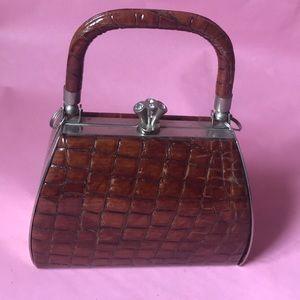 Vintage reddish brown silver/leather mini bag